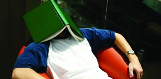 Guy with book on head