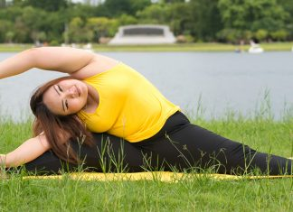 A young woman stretching in the grass
