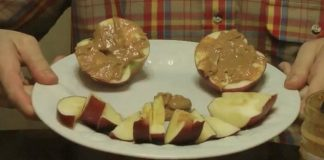 Apples with peanut butter in the shape of a smiley face