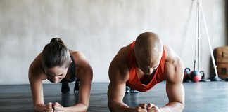 Two people doing planks next to each other