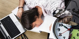 A student sleeping on his notebooks