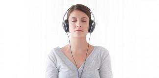 A young woman meditating with headphones