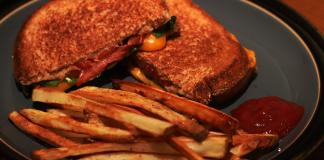 A plate with a sandwich and fries