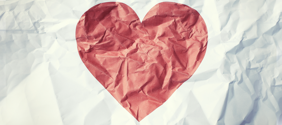 Crumbled piece of paper with a heart on it