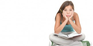 Frustrated girl sitting with notebook in her lap