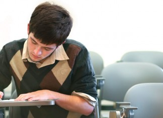 Young man taking a test in class