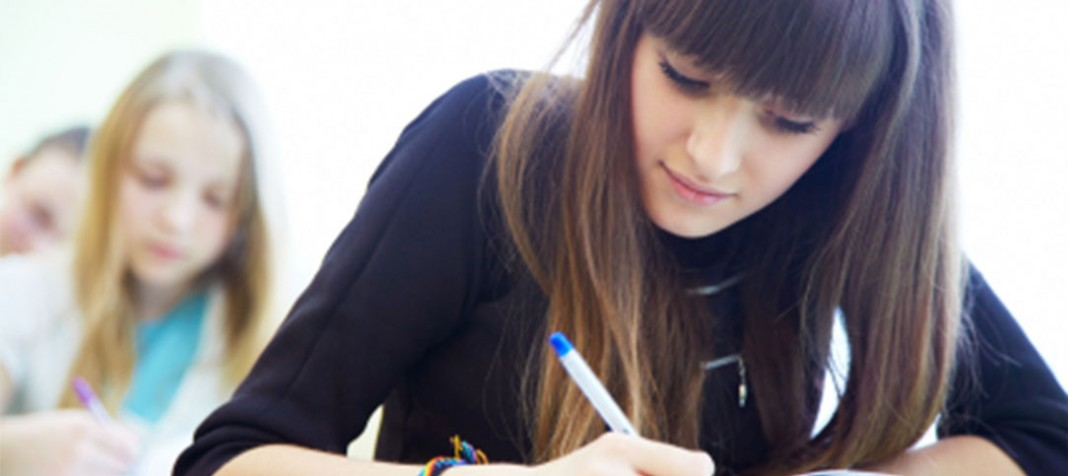 Young woman writing down notes