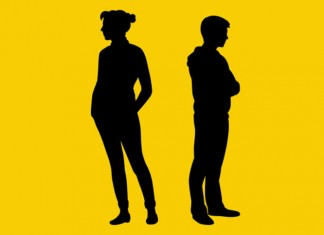 Two silhouette people standing facing away from each other