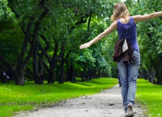 Young girl walking on a wooded path