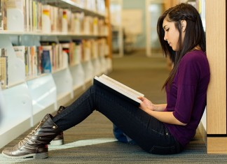 Female studying in the library