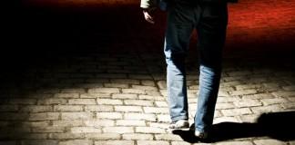 Man walking alone in dark area